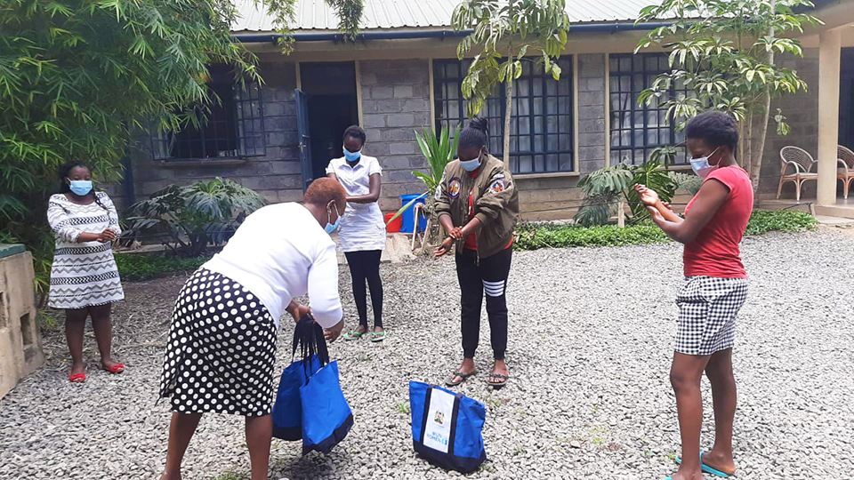 Distribution of dignity packs to quarantine and isolation facilities in Kiambu Hospital in Kenya to women by the County director for gender and health officials