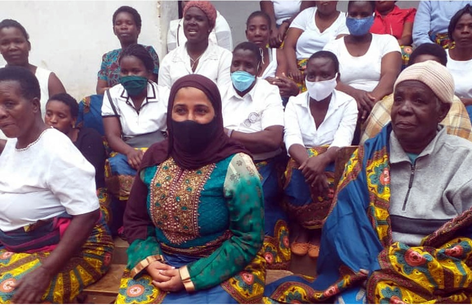 Councillor Munira joins a women's group in a visit to the elderly of the Likangala ward to give them psycho-social and material support.