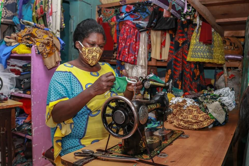 A tailor making masks in Kawangware. 110 women were trained on mask production in 2020.