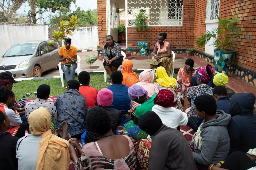 Prior to the departure of the 32 human trafficking survivors from Burundi, UGANET staff with interpretation support shared some final words of encouragement after their stay at the shelter (UGANET). Photo: UN Women/Eva Sibanda.
