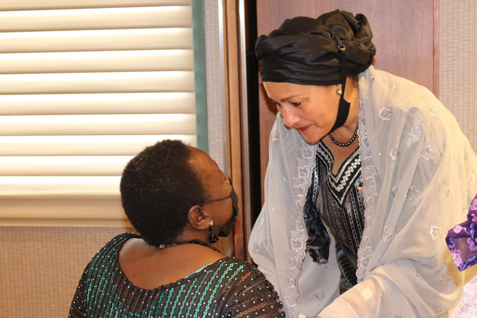 Amina Mohammed shares a moment with Lois Auta of the Network of Disabled Women