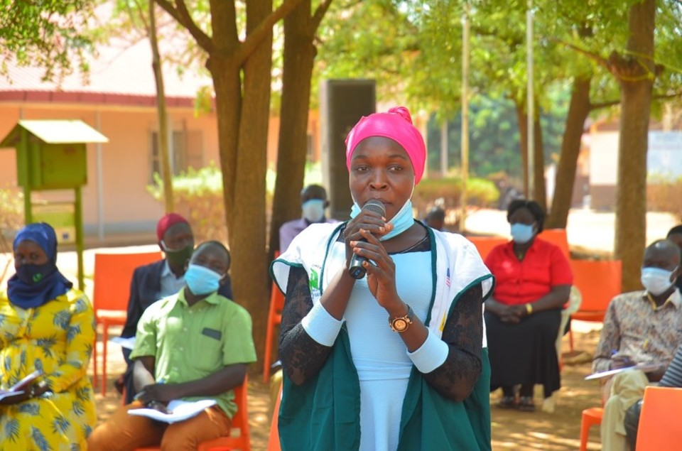 Afisa, reciting a poem during the launch of the Yumbe District Local Action Plan in March 2021. Photo credit: CoACT