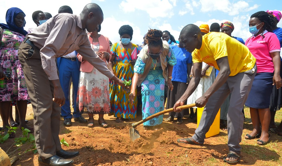 UN Women Deputy Country Representative, Ms. Adekemi Ndeili planting a tree during the launch of the Kaberamaido LAP in March 2021. Photo: Coalition for Action (CoACT)