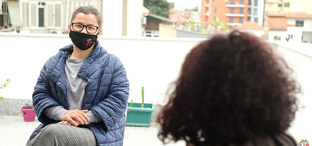 Ana Lila, head of the multidisciplinary team at Different and Equal talking to a survivor of violence.