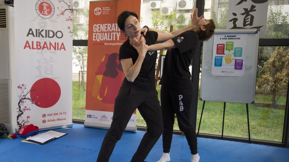 Gentiana Susaj (left), Aikido black belt (Shodan) and certified instructor for Empowerment through Self Defense with a participant during the training. Credit: UN Women Albania/Marsel Dajçi