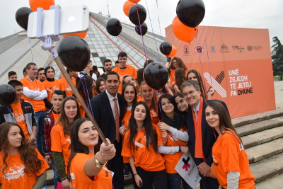UN Women Representative David Saunders and the Swedish Ambassador Johan Ndisi take a selfie with young activists on International Day to End Violence against Women Photo credit: Together for Life NGO