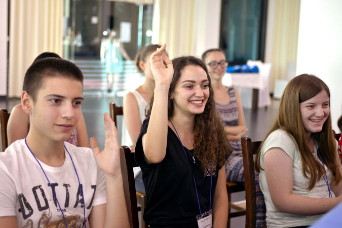 Young students participate in open forums with women candidates at the public forum in Durres, Albania. Photo: UN Women/Violana Murataj