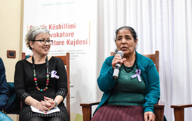Member of the Roma Community (right) at International Women's Day awareness raising event in Elbasan, Albania Photo credit: Women Forum Elbasan Organization