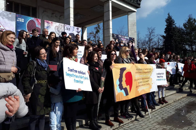 Women and men standing in solidarity with all women. They held speeches about the true meaning of gender equality, that #timeisnow to end gender-based violence and how important it is to support women's rights movement. photo credits: UN Women Moldova/Marina Vatav