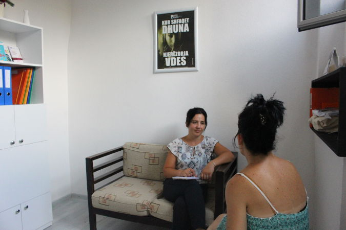 Borjana Korumi, Project Coordinator at the Human Rights in Democracy Centre, talking with a domestic violence survivor at a shelter in Kamza, Albania. Credit: UN Women Albania/Yllka Parllaku