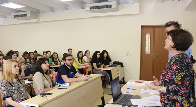 """Bajana Ceveli of """"Association of Women with Social Problems"""" with students of the Faculty of Law in Tirana, Albania. Photo: UN Women Albania"""