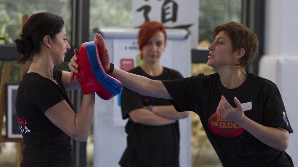 Gentiana Susaj (left), Aikido black belt (Shodan) and certified instructor for Empowerment through Self Defense with a participant during the training. Photo: UN Women Albania/Marsel Dajçi