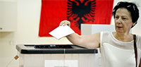 Photo: UN Women Albania/Violana Murataj. Woman voting at 2017 parliamentary elections in Albania