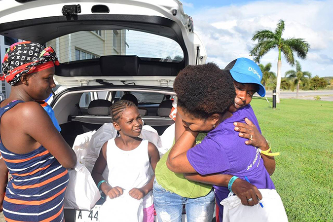 Dignity Kits distribution begins for Barbuda women and girls impacted by Hurricane Irma and Jose