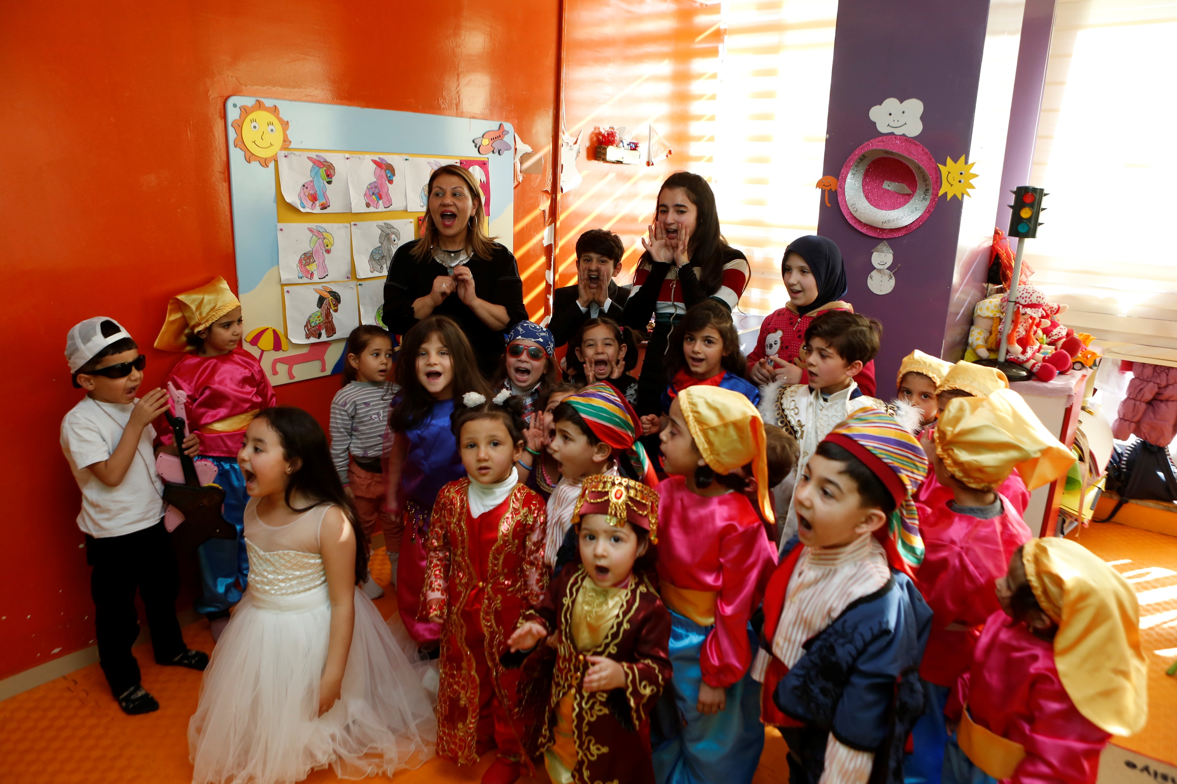 """In the words of Ayşegül Özdil: """"When you build communication among children of different cultures, the day after you see the effect on their mothers."""""""