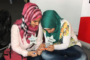 Girls doing one of the exercises at the scientific workshop organized by UN Women, UNESCO and the Scientific Culture Society; Irbid. Photo: UN Women Jordan