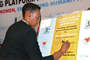 First Lady Janet K. Museveni signs a plaque to officially launch the campaign