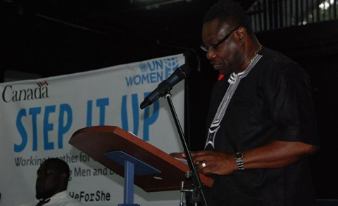The Honorable Steven Blackett Minister of Social Care, Constituency Empowerment and Community Development delivering opening remarks at the IWD Town Hall Meeting