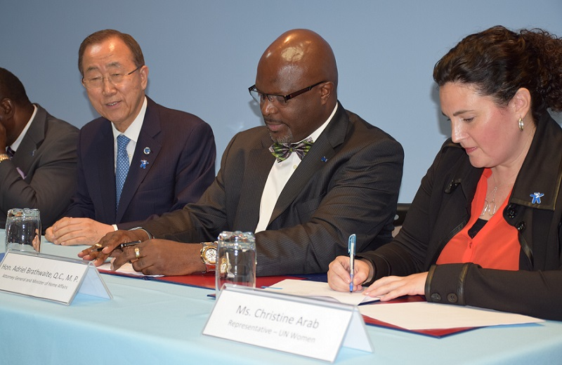United Nations Secretary-General Ban Ki-moon, Attorney General looks on as Minister of Home Affairs of Barbados, the Hon. Adriel Brathwaite Q.C. M.P. and UN Women Representative Christine Arab sign a MOU between UN Women and the Government of Barbados/Office of the Attorney General