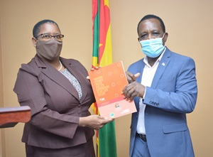 Elaine McQueen handing over report to Prime Minister Dr. Keith Mitchell