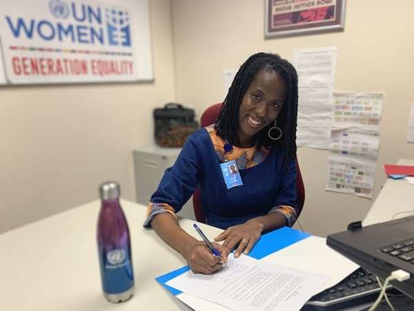 UN Women MCO Caribbean Representative a.i. Tonni Brodber signing the UDC/UN Women MOU during the virtual event.