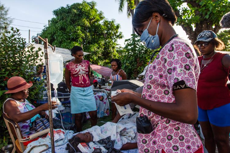 Haitian medical personnel attend to patient