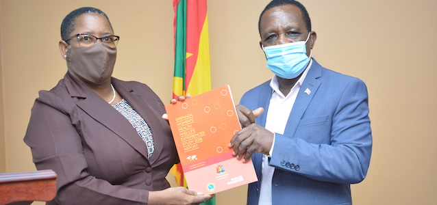 Dr. The Right Honourable Keith Mitchell, Prime Minister of Grenada receives The Grenada Women's Health and Life Experiences Study Report from Elaine Henry McQueen, Senior Programme Officer - Ministry of Social Development. Photo Credit: GIS Grenada Photo/Carlyle Noel.