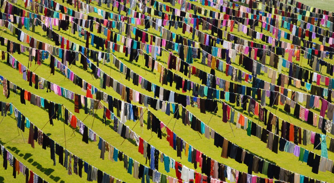 Dresses and skirts hang in lines in the football stadium of the city of Pristina in Kosovo.