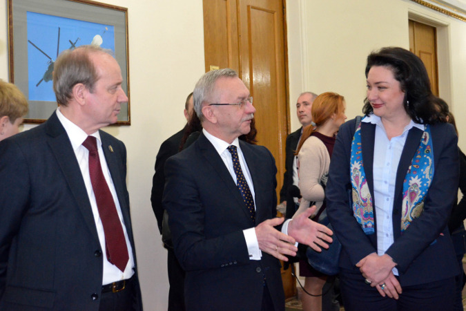 Ivan Rusnak, the First Deputy Minister of Defense, Ihor Dolgov, Deputy Minister of Defense on European Integration, and Anastasia Divinskaya, UN Women Gender Advisor, at the opening of the exhibition