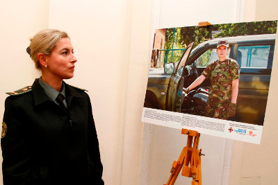 A staff member of the Ministry of Defense at the exhibition
