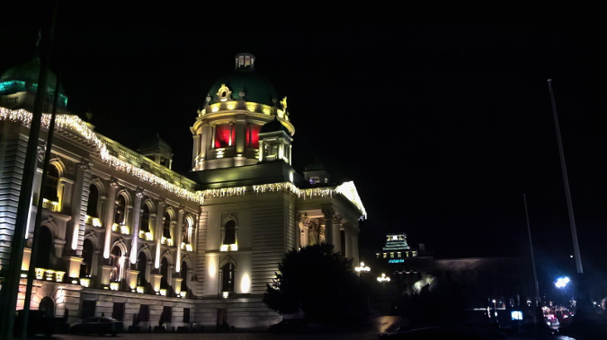 The Serbian Parliament in Belgrade, Serbia, lit orange. Photo: UN Women/Bojana Barlovac