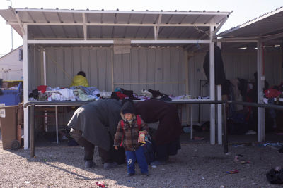 Women collecting donated clothes for themselves and their children in Tabanovce near the Macedonia and Serbia border, photo credit: Mirjana Nedeva