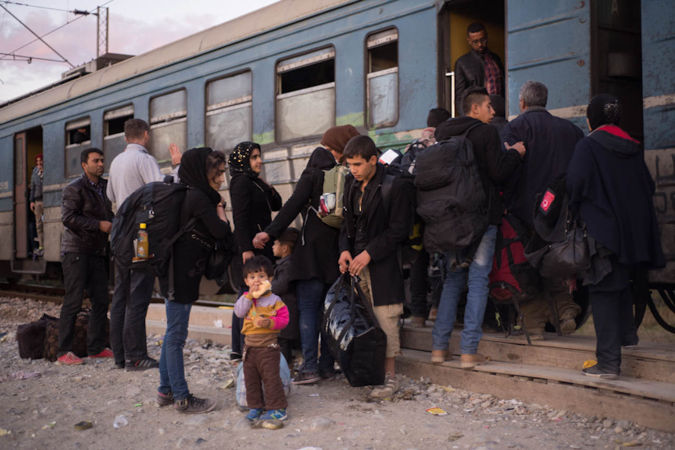 Refugees getting ready for the train in Gevgelija to travel to the border with Serbia, photo credit: Mirjana Nedeva