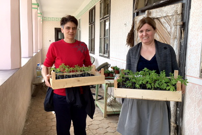 "Dalida and Ljiljana are happy to say that new seeds and plants are coming to ""Good Garden"". Photo credit: Bojana Barlovac/UN Women"
