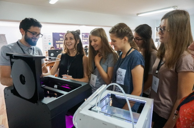 Girls interacting with a 3D printer. They have printed their first 3D designs. Photo: GirlsGoIT