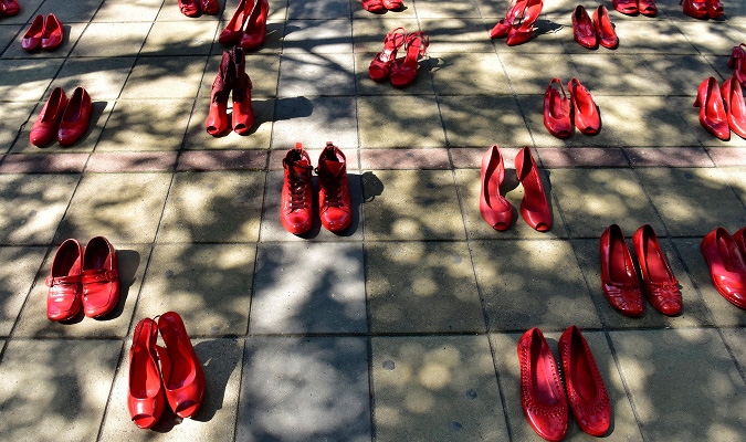 40 pairs of red shoes have found its place in front of the Serbian Government's building as a reminder that more than 40 women in the country are killed every year by their intimate partner.  Photo: Marija Jankovic