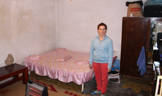 Semiha Xhani in her 20 square meter room with one window. Photo: UN Women/Yllka Parllaku
