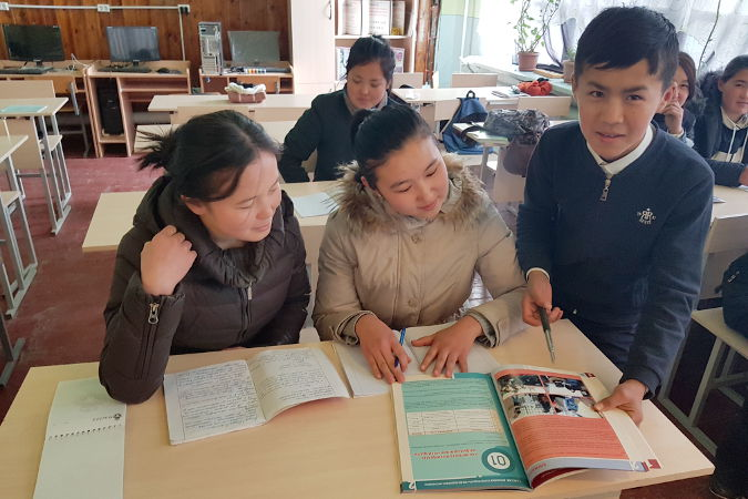 Erlan is conducting peer education sessions for his peer mates on effective use of water resources. Photo: UN Women/Dildora Khamidova