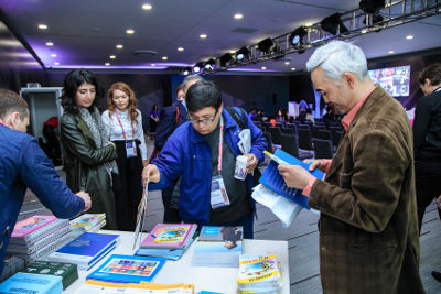 Participants of the panel session are getting the UN Women knowledge products. Photo: UN Women Kazakhstan/Batyr Aubakirov