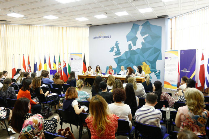 Members of the Monitoring Network against Gender-Based Violence and civil society organizations in a forum discussing gender based violence issues in Albania. Monitoring Network against Gender-Based Violence