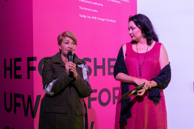 Iryna Danylevska, founder of Ukrainian Fashion Week (on the left) and Anastasia Divinskaya, Representative of the UN Women in Ukraine (on the right) deliver an opening speech at the Ukrainian Fashion Week. Photo:UN Women/Volodymyr Shuvayev