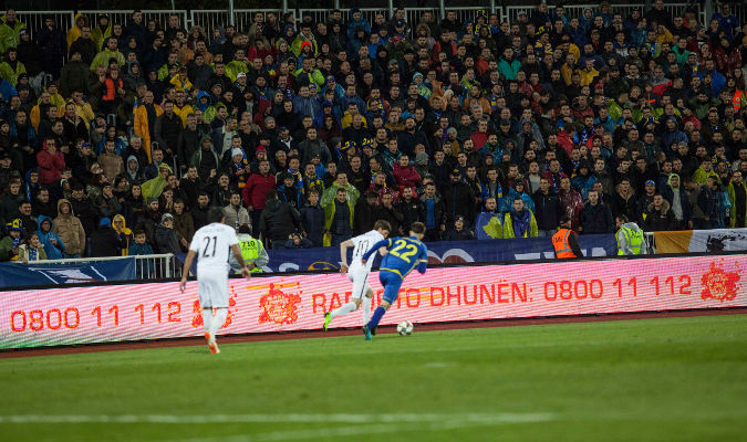 Campaign slogans on pitchside LED billboards during match. Photo: UN Kosovo Team