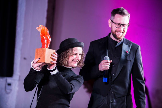 The representative of the winner of HeForShe Women in Arts Award in Music, Nina Harenetska (left), receives the prize.  Nina Hlanevych, member of Dakh Daughters band and Yurii Marchenko (right), the host of the event. Photo: UN Women/Volodymyr Shuvayev