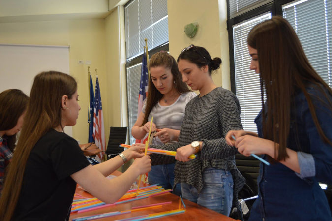 Participants build bridges in one of the workshops held for the Girls in ICT Day. Photo: UN Women in Kosovo
