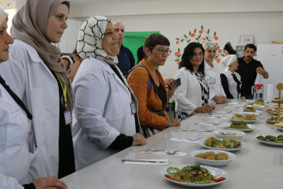 The delegates taste local pastries made by refugee and local women at the SADA Women-only Centre. Photo: Megumi Iizuka