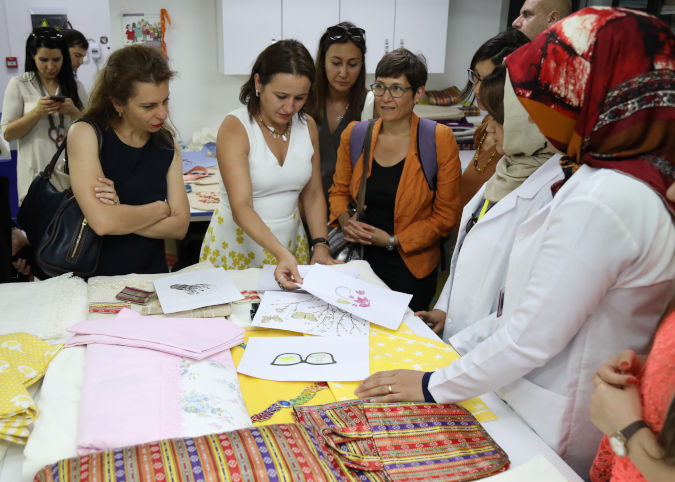 Donors and partners are briefed about textile production at the SADA Women-only Centre. Photo: Serenas Tourism