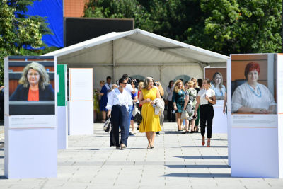Exhibition in the city center of Pristina featuring portraits of Women's Caucus Members. Photo: UN Women