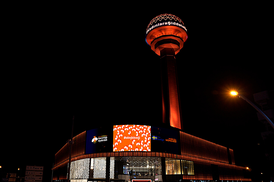 Atakule, a tower in the capital city of Turkey, lit up in orange.