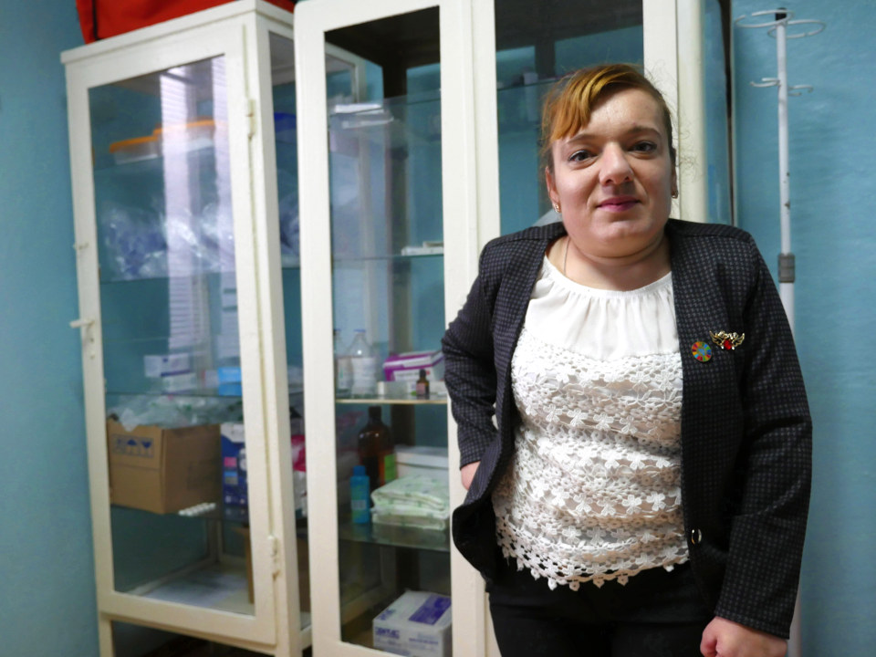 Elena Crasmari, who stands in her village's medical centre, ran for local counselor as an independent candidate