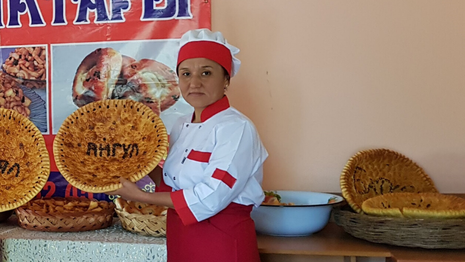 As a self-help group member in Arka village, Janyjer municipality, Gulyaim Dobutova provides bakery services.